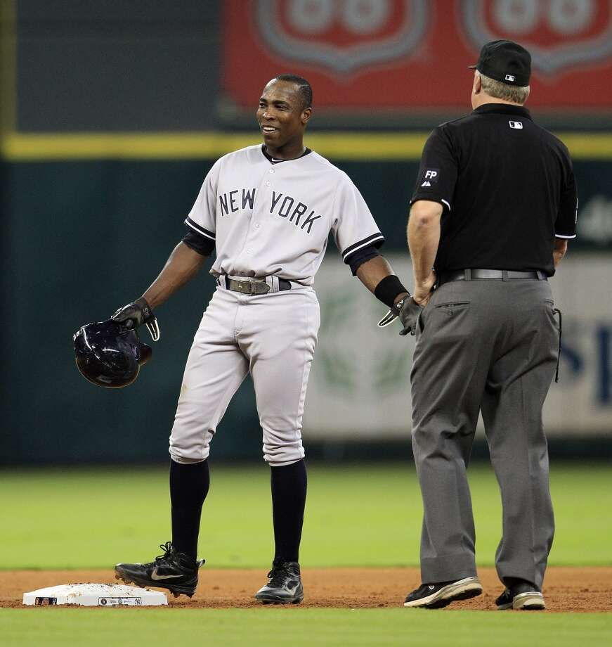 Yankees left fielder Alfonso Soriano (12) chats with Umpire Bill Miller  as he stands on second. Photo: Karen Warren, Houston Chronicle
