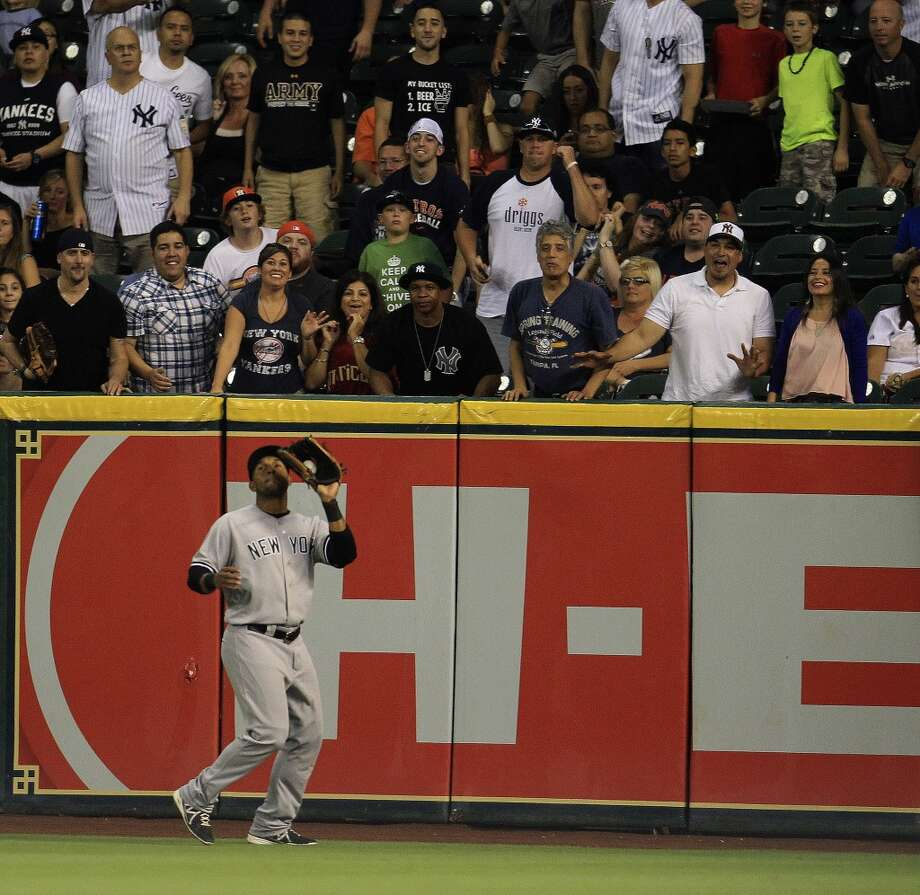 Yankees left fielder Zoilo Almonte (63) makes a catch on a fly out by Trevor Crowe. Photo: Karen Warren, Houston Chronicle