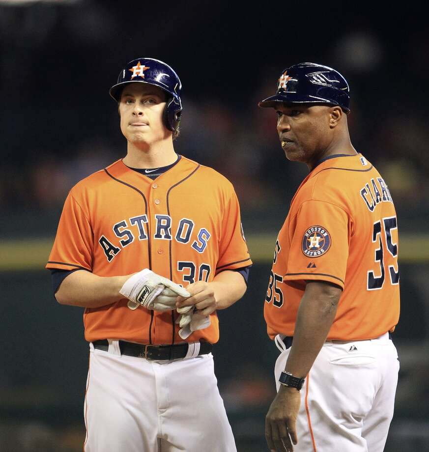 Astros third baseman Matt Dominguez (30) reacts with first base coach Dave Clark (35) after flying out with bases loaded. Photo: Karen Warren, Houston Chronicle