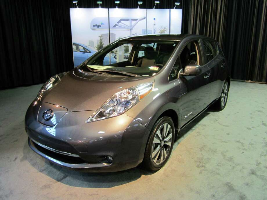 Customers who purchase the Nissan Leaf, displayed at the State Fair of Texas auto show this year, between Oct. 1 and March 31 in the Dallas and Houston areas, can access any of NRG eVgo's electric vehicle charging stations free of charge for a year. / Neal Morton/San Antonio Express News