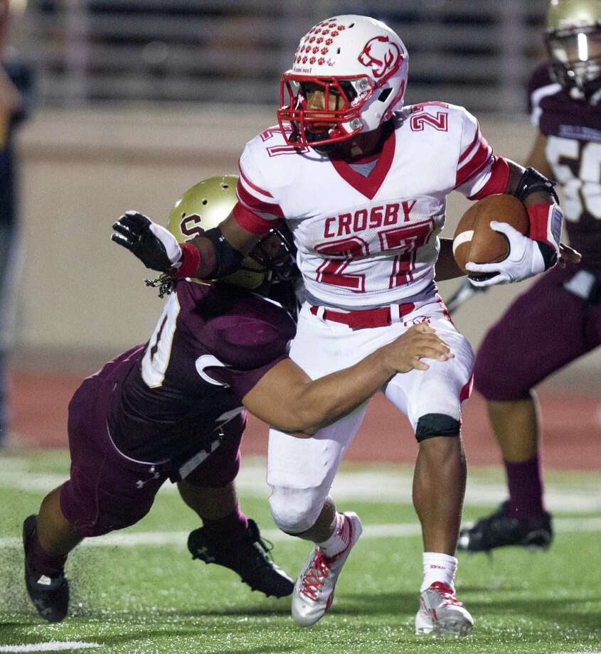 Crosby's Austin Walter (27) runs for a first down during the second half of a high school football game against Summer Creek at Turner stadium  on Friday, Sept. 27, 2013, in Humble. Photo: J. Patric Schneider, For The Chronicle / © 2013 Houston Chronicle
