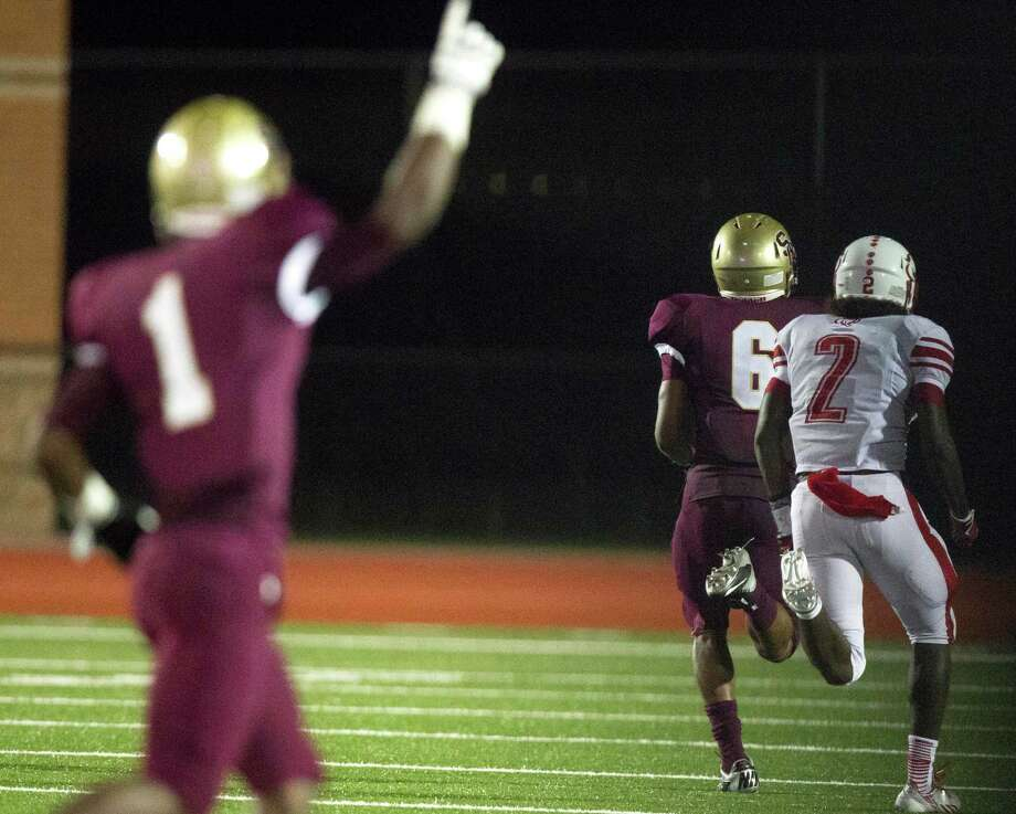 Summer Creek's Torrey Johnson (6) runs in for a touchdown during the second half of a high school football game against Crosby at Turner stadium on Friday, Sept. 27, 2013, in Humble. Photo: J. Patric Schneider, For The Chronicle / © 2013 Houston Chronicle