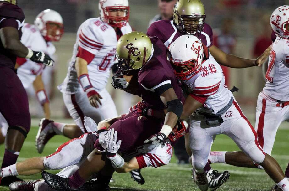 Summer Creek's De'unte Chatman is taken down by Crosby's Frank Foley (30) during the second half of a high school football game at Turner stadium on Friday, Sept. 27, 2013, in Humble. Photo: J. Patric Schneider, For The Chronicle / © 2013 Houston Chronicle