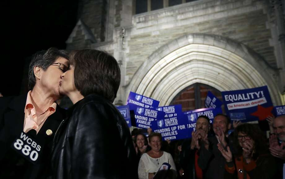 Cindy Meneghin (left) and Maureen Kilian celebrate in Montclair, N.J., hours after a Superior Court judge ruled that New Jersey's prohibition on same-sex marriage is unconstitutional. Photo: Julio Cortez, Associated Press