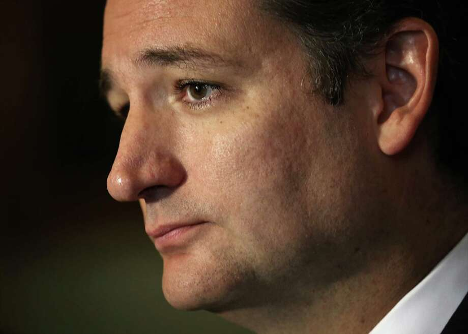 U.S. Sen. Ted Cruz (R-TX) speaks to members of the media after a vote on the Senate floor, Sept. 27, 2013. Photo: Getty Images / 2013 Getty Images