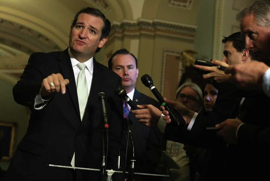 WASHINGTON, DC - SEPTEMBER 27:  U.S. Senator Ted Cruz (R-TX) (L) and Senator Mike Lee (R-UT) (R) speak to members of the media after a vote on the Senate floor September 27, 2013 on Capitol Hill in Washington, DC. The Senate has passed a continuing resolution 54-44 to fund the government through November 15 with the exclusion of defunding the Obama care in which the provision was passed in the House.  (Photo by Alex Wong/Getty Images) Photo: Getty Images / 2013 Getty Images
