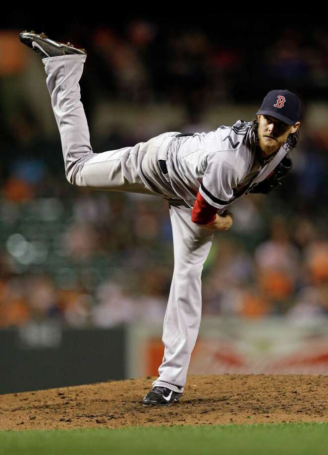 Boston Red Sox starting pitcher Clay Buchholz follows through on a pitch to the Baltimore Orioles in the fourth inning of a baseball game, Friday, Sept. 27, 2013, in Baltimore. (AP Photo/Patrick Semansky) ORG XMIT: MDPS108 Photo: Patrick Semansky / AP