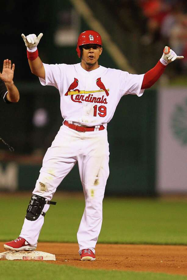 ST. LOUIS, MO - SEPTEMBER 27:  Jon Jay #19 of the St. Louis Cardinals acknowledges his teammates after hitting a double against the Chicago Cubs in the fifth inning at Busch Stadium on September 27, 2013 in St. Louis, Missouri.  (Photo by Dilip Vishwanat/Getty Images) ORG XMIT: 163495788 Photo: Dilip Vishwanat / 2013 Getty Images
