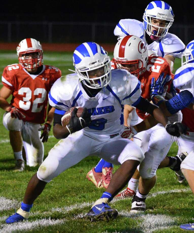 Shaker's #8 Andrew Bolton carries the ball  during Friday night's game against Guilderland Sept. 27, 2013, in Guilderland.  (John Carl D'Annibale / Times Union) Photo: John Carl D'Annibale / 00024012A