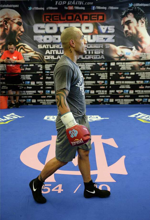 HOLLYWOOD, CA - SEPTEMBER 18:  Miguel Cotto walks around the ring during a break in his training session for his fight against Delvin Rodriguez at Wild Card Boxing Club on September 18, 2013 in Hollywood, California. Photo: Harry How, Getty Images / 2013 Getty Images