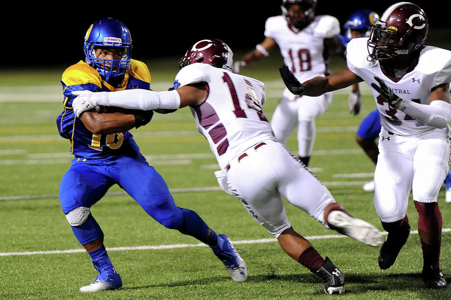 Ozen's Ronnie Ceaser, 16, tries to dodge Central's Derek Broussard, 14, at the Carroll Thomas Stadium Friday night. Photo by Drew Loker. Photo: Drew Loker