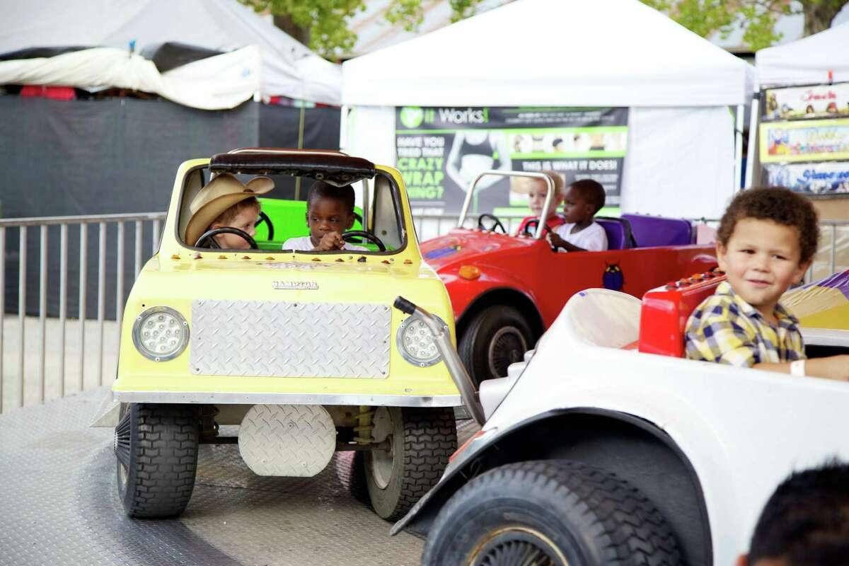 Fair goers enjoy the Comal County Fair on Friday, Sept. 27, 2013.