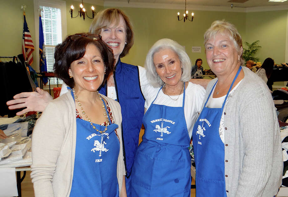 Westport Woman's Club volunteers Susan Fox, Ruth Ann Carroll, Karen Eickhoff and Linda Amos at the club's clothing tag sale. Photo: Mike Lauterborn / Westport News contributed
