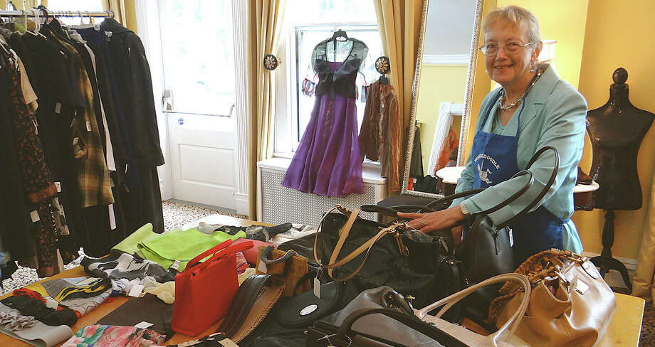 Westport Woman's Club volunteer Jerilyn Deveau in the boutique section at the club's clothing tag sale. Photo: Mike Lauterborn / Westport News contributed