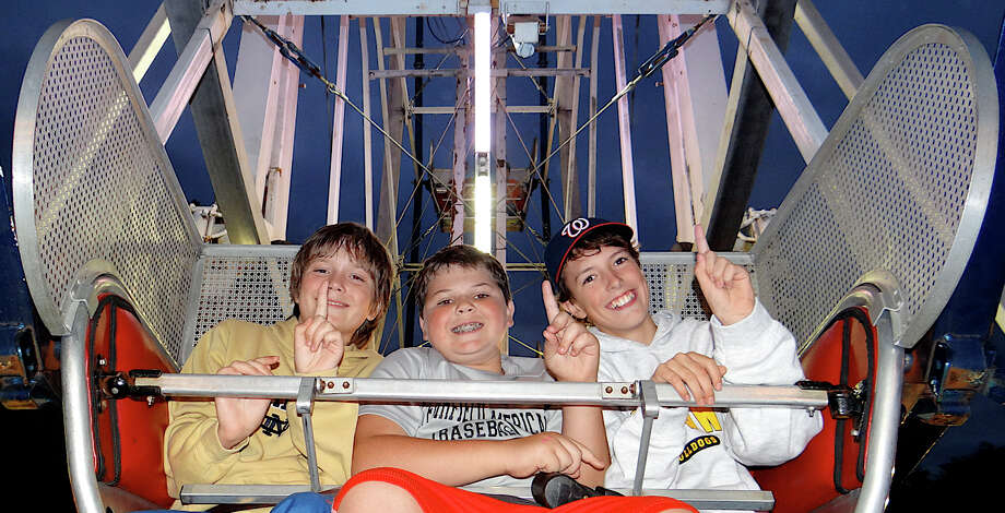 Nick Macri, 11; Blake Benway, 11, and Sam Sweeney, 12, on the Ferris wheel Friday at the Dwight fair.  FAIRFIELD CITIZEN, CT 9/27/13 Photo: Mike Lauterborn / Fairfield Citizen contributed