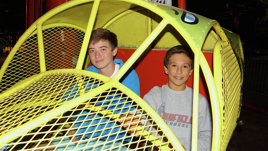 Duncan Crow, 14, and Crawford Mitchell, 13, enjoy the Salt & Pepper Shaker ride at the Dwight School fair. FAIRFIELD CITIZEN, CT 9/27/13 Photo: Mike Lauterborn / Fairfield Citizen contributed