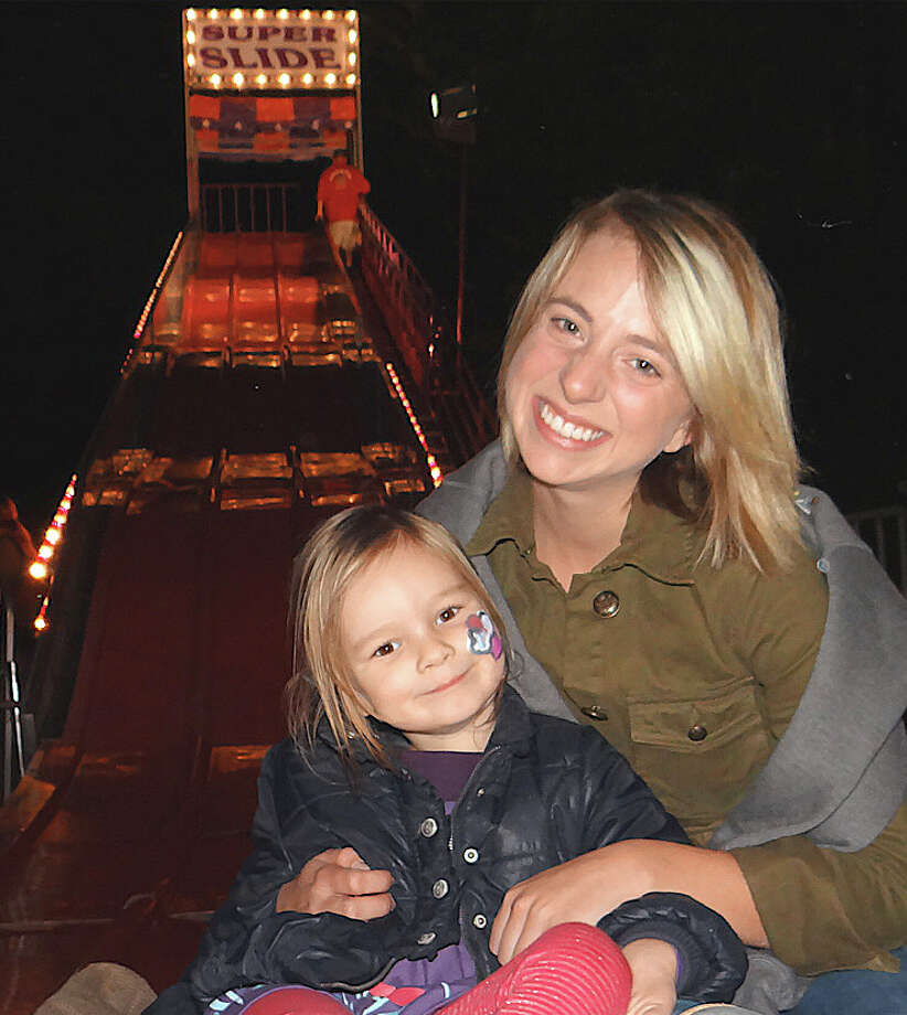 Weston residents April Ferris, 3, and Becca Rosebloom enjoy the Super Slide at the opening night of the Dwight School fair on Friday night.  FAIRFIELD CITIZEN, CT 9/27/13 Photo: Mike Lauterborn / Fairfield Citizen contributed