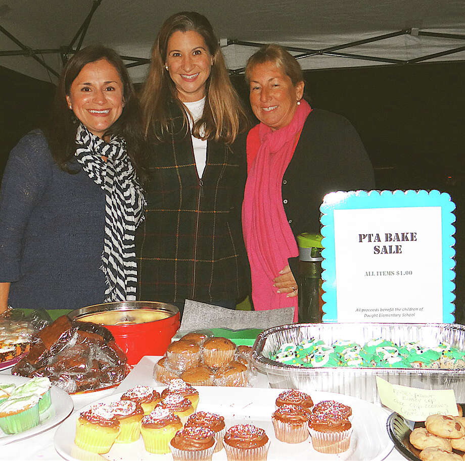 Dwight School PTA members Paula Abbott, Kristin Mayhew and Jodi Flora staffing the sale of baked goods Friday night at the Redding Road school's annual fair.   FAIRFIELD CITIZEN, CT 9/27/13 Photo: Mike Lauterborn / Fairfield Citizen contributed