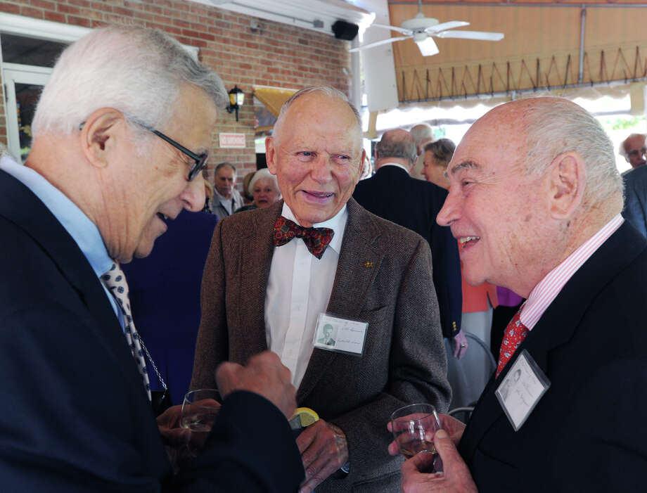 Former Greenwich High School classmates reminisce, they are from left, Tony Guido of Cos Cob, Don Worn of Los Gatos, Calif., and former five-time Greenwich First Selectman, John Margenot, during their 67th reunion of the Greenwich High School Class of 1946 in the Fairways Restaurant at the Griffith E. Harris Memorial Golf Course, Greenwich, Saturday, Sept. 28, 2013. Photo: Bob Luckey / Greenwich Time
