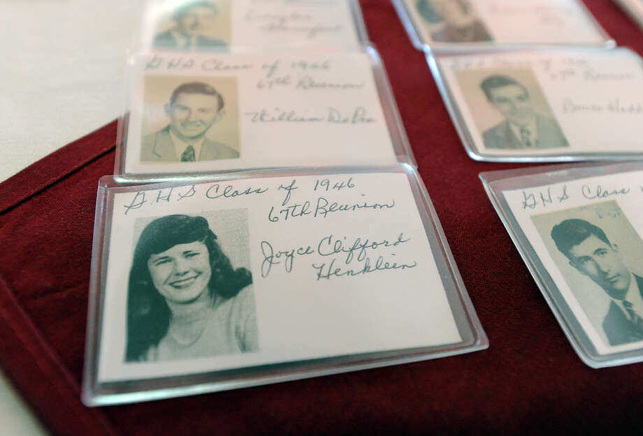Name tags with Greenwich High School yearbook photos from 1946 on a table during the 67th reunion of the Greenwich High School Class of 1946  in the Fairways Restaurant at the Griffith E. Harris Memorial Golf Course, Greenwich, Saturday, Sept. 28, 2013. Photo: Bob Luckey / Greenwich Time