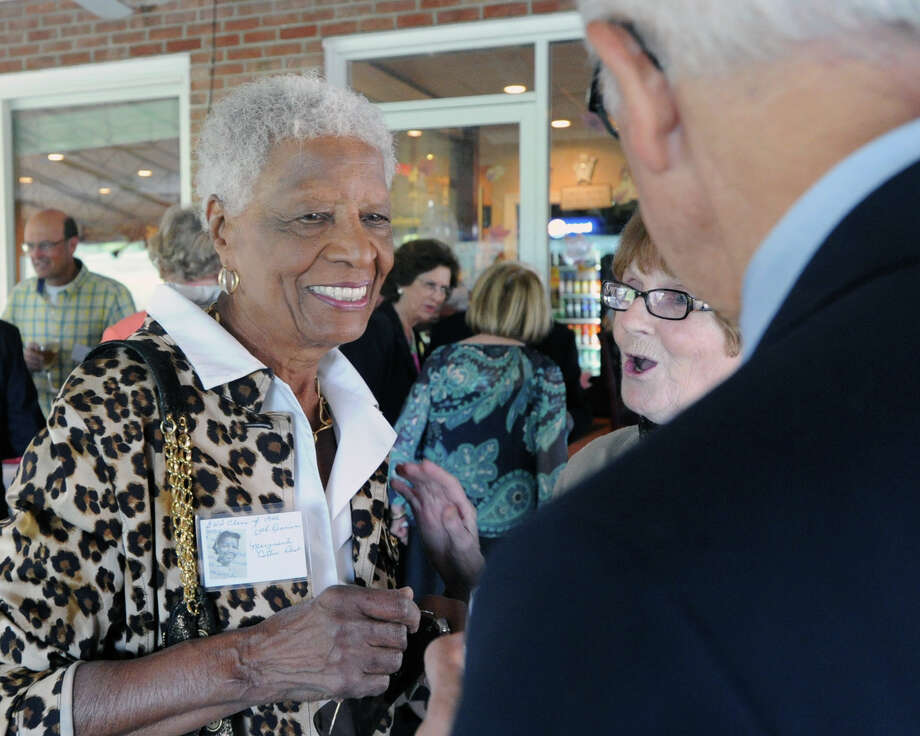 At left, Marguerite Carter Best, 86, of White Plains, N.Y., shares a laugh with some of her former Greenwich High School classmates during the 67th reunion of the Greenwich High School Class of 1946 in the Fairways Restaurant at the Griffith E. Harris Memorial Golf Course, Greenwich, Saturday, Sept. 28, 2013. Photo: Bob Luckey / Greenwich Time