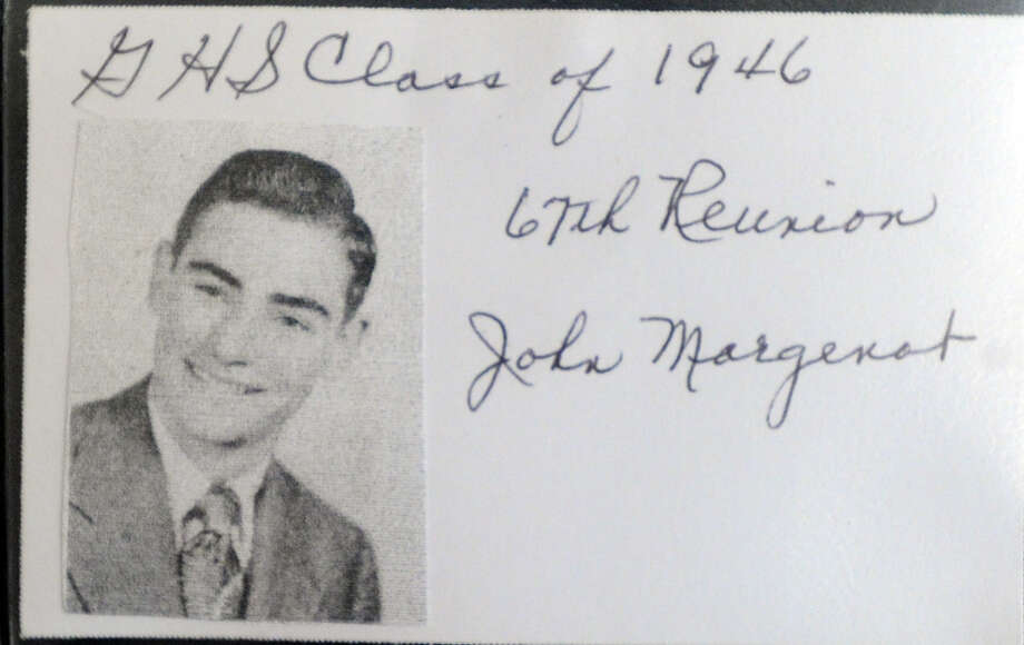 The 1946 Greenwich High School yearbook photo of former five-time Greenwich First Selectman, John Margenot, was visible on Margenot's jacket during the 67th reunion of the Greenwich High School Class of 1946  in the Fairways Restaurant at the Griffith E. Harris Memorial Golf Course, Greenwich, Saturday, Sept. 28, 2013. Photo: Bob Luckey / Greenwich Time