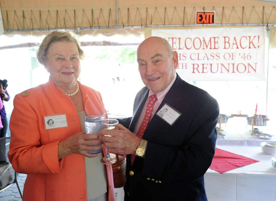 Former Greenwich High School classmates, Helen Buckley Gray, left, and former five-time Greenwich First Selectman, John Margenot, during the 67th reunion of the Greenwich High School Class of 1946  in the Fairways Restaurant at the Griffith E. Harris Memorial Golf Course, Greenwich, Saturday, Sept. 28, 2013. Photo: Bob Luckey / Greenwich Time