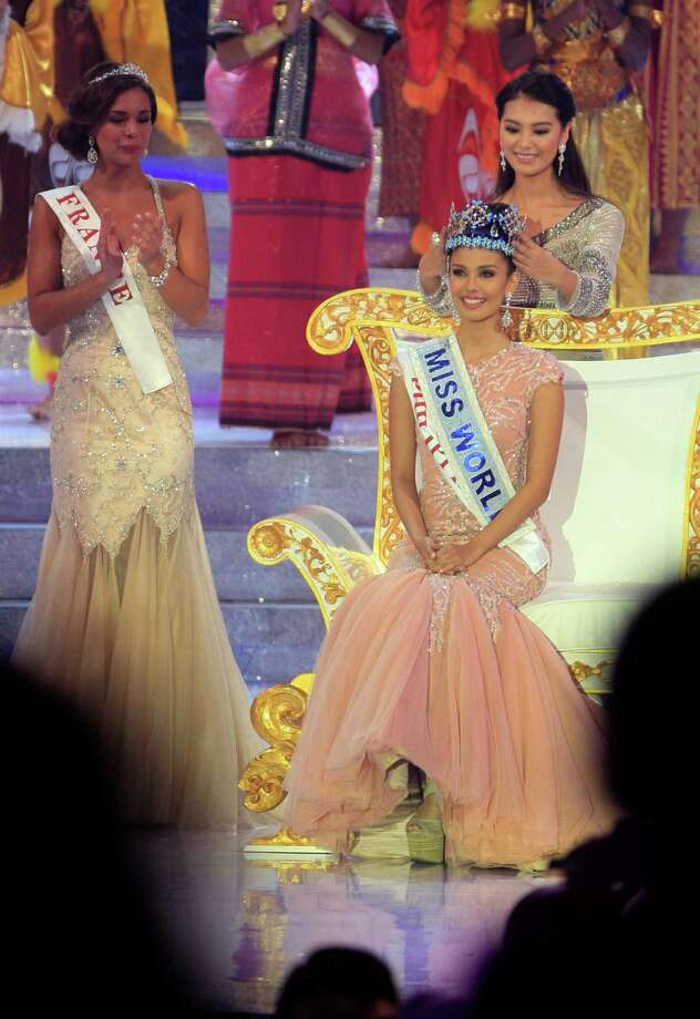 Megan Young of the Philippines, right, smiles after being named Miss World 2013 during the grand final of the pageant in Nusa Dua, Bali, Indonesia, onSaturday. Photo: AP