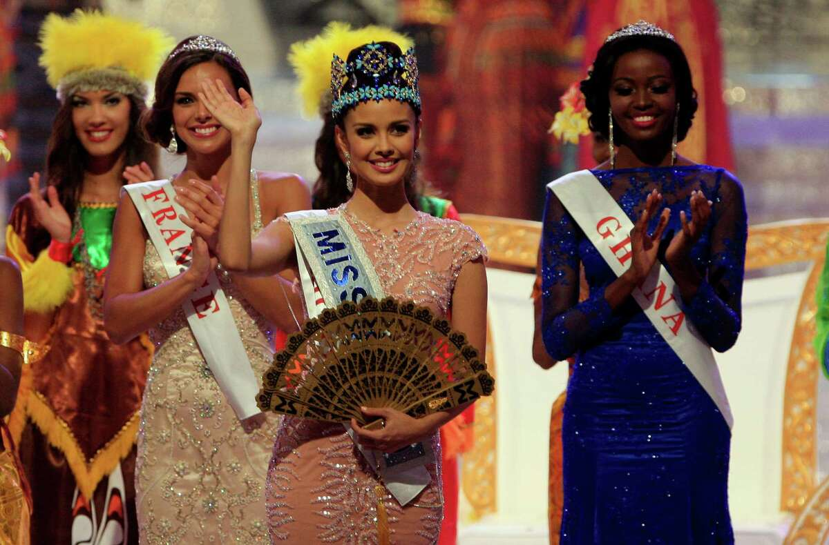 Newly crowned Miss World Megan Young of Philippine, center waves, after winning the Miss World contest, in Nusa Dua, Bali, Indonesia, Saturday, Sept. 29, 2013.