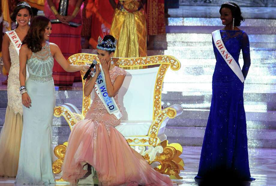 Newly crowned Miss World, Megan Young of the Philippines, center, reacts after winning the Miss World contest, Saturday. Photo: AP