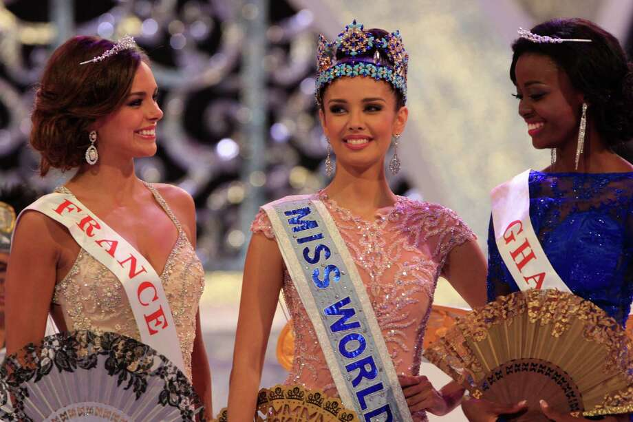 Newly crowned Miss World, Megan Young of Philippines, center, with second runner-up Miss France Marine Lorpheline, left, and third runner-up Miss Ghana Carranza Naa Okailey Shooter. Photo: AP