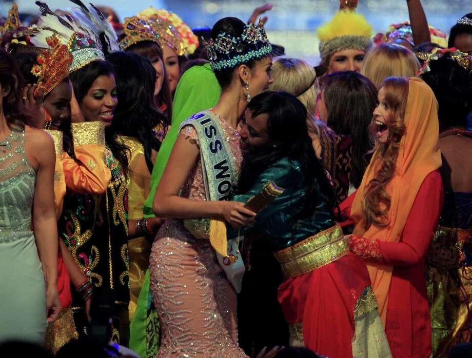 Newly crowned Miss World 2013 Megan Young of the Philippines, center, is congratulated by other contestants during the grand final of the pageant in Nusa Dua, Bali, Indonesia, on Saturday. Photo: AP