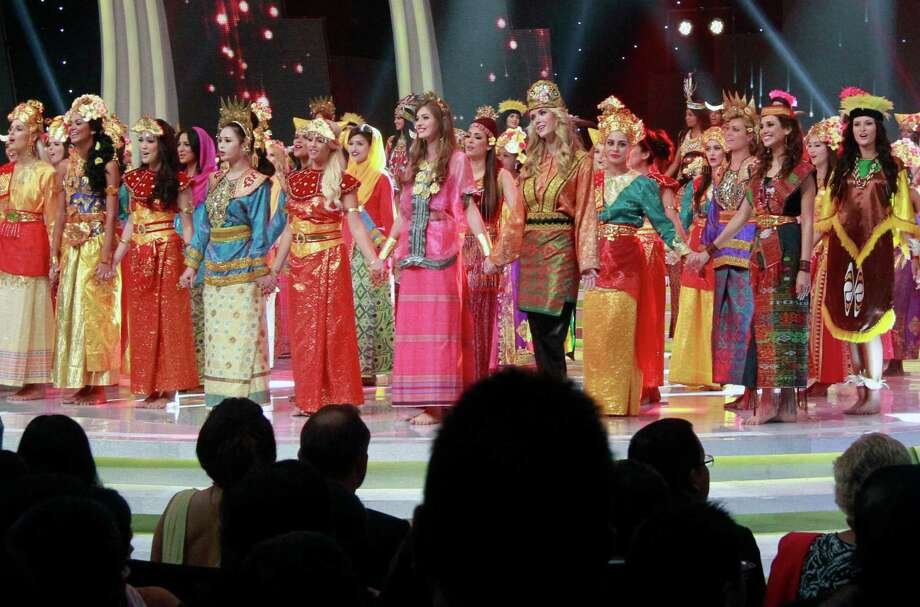 In this Sunday, Sept. 8, 2013 photo, contestants wear traditional Indonesian outfits during the opening ceremony of Miss World 2013 pageant in Nusa Dua, Bali, Indonesia. Beauty queens and backstage drama may seem inevitable, but at this year's Miss World competition, something more serious than hair-pulling and name-calling has come from host country Indonesia: Muslim hardliners have threatened to hijack the competition despite major concessions from the government and organizers. Photo: AP