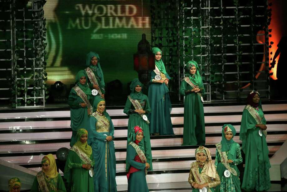 Wednesday, Sept. 18, 2013 photo, contestants line up on the stage during the 3rd Annual Award of World Muslimah, a competition billed as the Islamic alternative to Miss World pageant, in Jakarta, Indonesia. Beauty queens and backstage drama may seem inevitable, but at this year's Miss World competition, something more serious than hair-pulling and name-calling has come from host country Indonesia: Muslim hardliners have threatened to hijack the competition despite major concessions from the government and organizers. Photo: AP