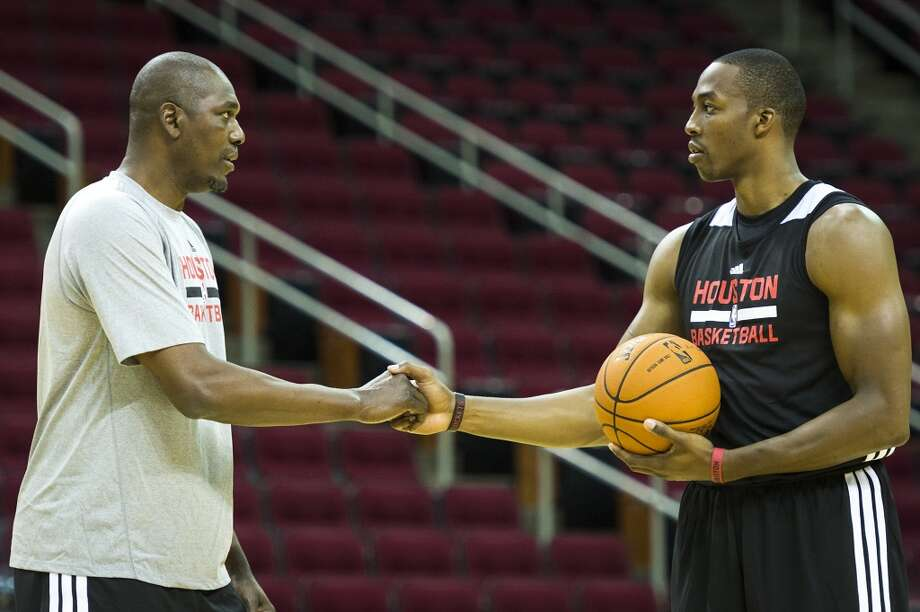 Hakeem Olajuwon works works with Houston Rockets center Dwight Howard during the first practice of the team's preseason training camp at Toyota Center on Saturday, Sept. 28, 2013, in Houston. Photo: Smiley N. Pool, Houston Chronicle