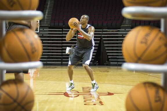 Rockets center Dwight Howard shoots baskets during the first practice.