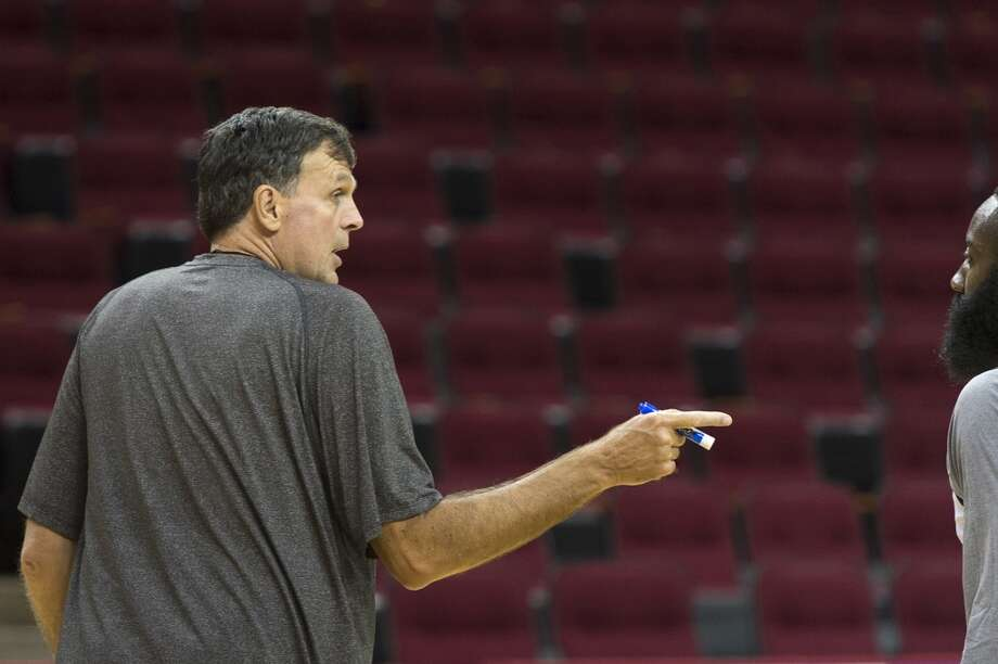 Rockets head coach Kevin McHale talks with James Harden. Photo: Smiley N. Pool, Houston Chronicle