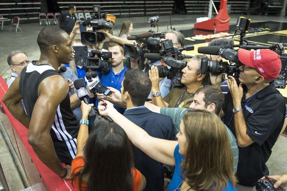 Rockets center Dwight Howard faces a crowd of media after the first practice. Photo: Smiley N. Pool, Houston Chronicle