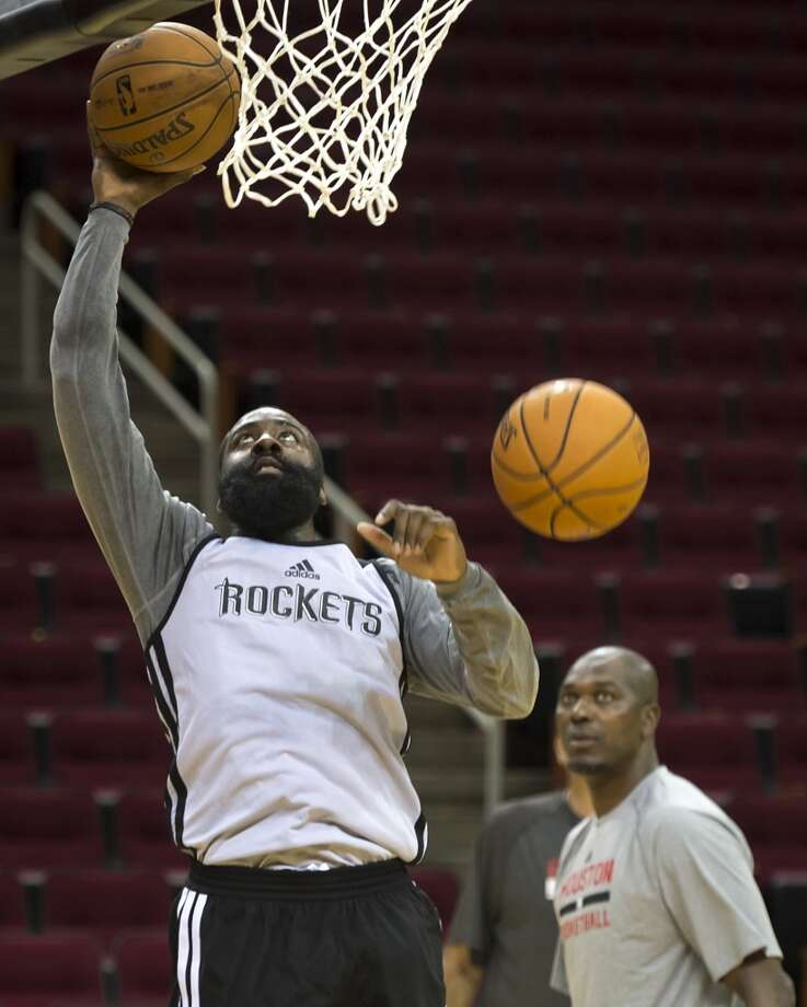 Rockets shooting guard James Harden puts up a shot as Hakeem Olajuwon looks on. Photo: Smiley N. Pool, Houston Chronicle