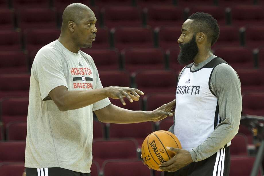 Olajuwon works works with Houston Rockets guard James Harden during the first practice of the training camp. Photo: Smiley N. Pool, Houston Chronicle