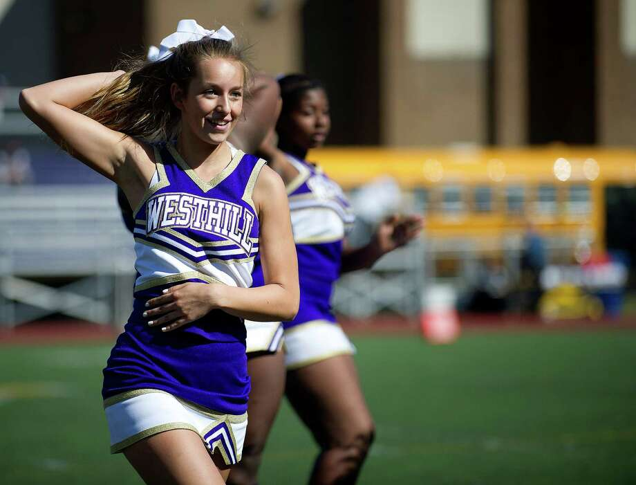 Westhill cheerleaders perform at halftime during Saturday's football game in Stamford, Conn., on Sept. 28, 2013. Photo: Lindsay Perry / Stamford Advocate