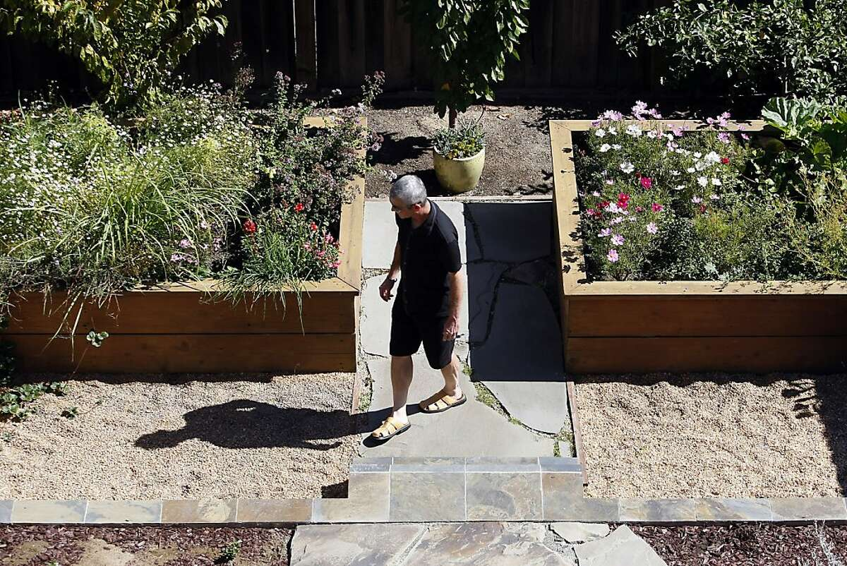 A guest visits the garden of Dominic and Holly Restani during the annual Portola Garden Tour in San Francisco, California Saturday, September 28, 2013.