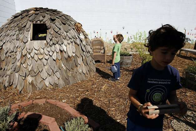 "Students Evelyn Stanley, left, and Owen Delwiche play in the ""Owl House"" with Sam Toeman in the garden at Alta Vista Elementary School during the annual Portola Garden Tour in San Francisco, California Saturday, September 28, 2013. Photo: Michael Short, The Chronicle"