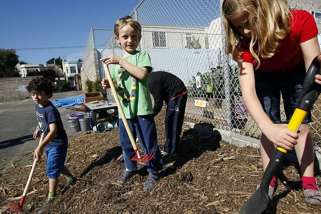 "(L-R)Students Sam Toeman, Owen Delwiche Brandon Strauss and Evelyn Stanley dig in the ""Mulch Mountain"" at the Alta Vista Elementary School garden during the annual Portola Garden Tour in San Francisco, California Saturday, September 28, 2013. Photo: Michael Short, The Chronicle"