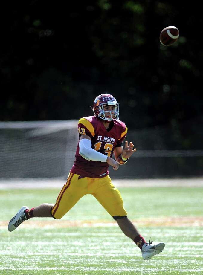 St.Joseph quarterback Jordan Vazzano passes the ball Saturday, Sept. 28, 2013 during their game with Ridgefield at St. Joseph High School in Trumbull, Conn. Photo: Autumn Driscoll / Connecticut Post