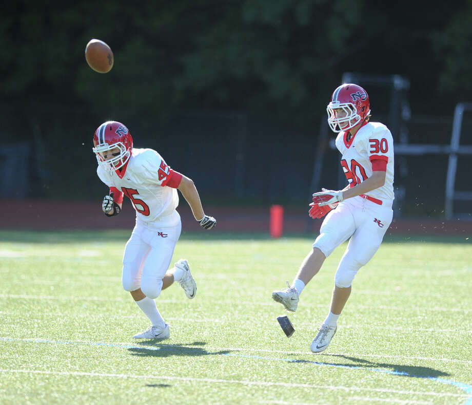 Pete Swindell (# 30) of New Canaan kicks-off at the start of the high school football game between Greenwich High School and New Canaan High School at Greenwich, Saturday, Sept. 28, 2013. Photo: Bob Luckey / Greenwich Time