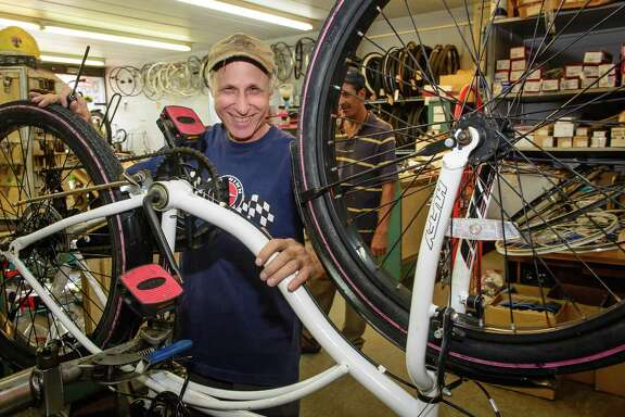 Brian Bazaman, owner of West End Cycle, tries to keep smiling but says that his business is still struggling five years after Ike.