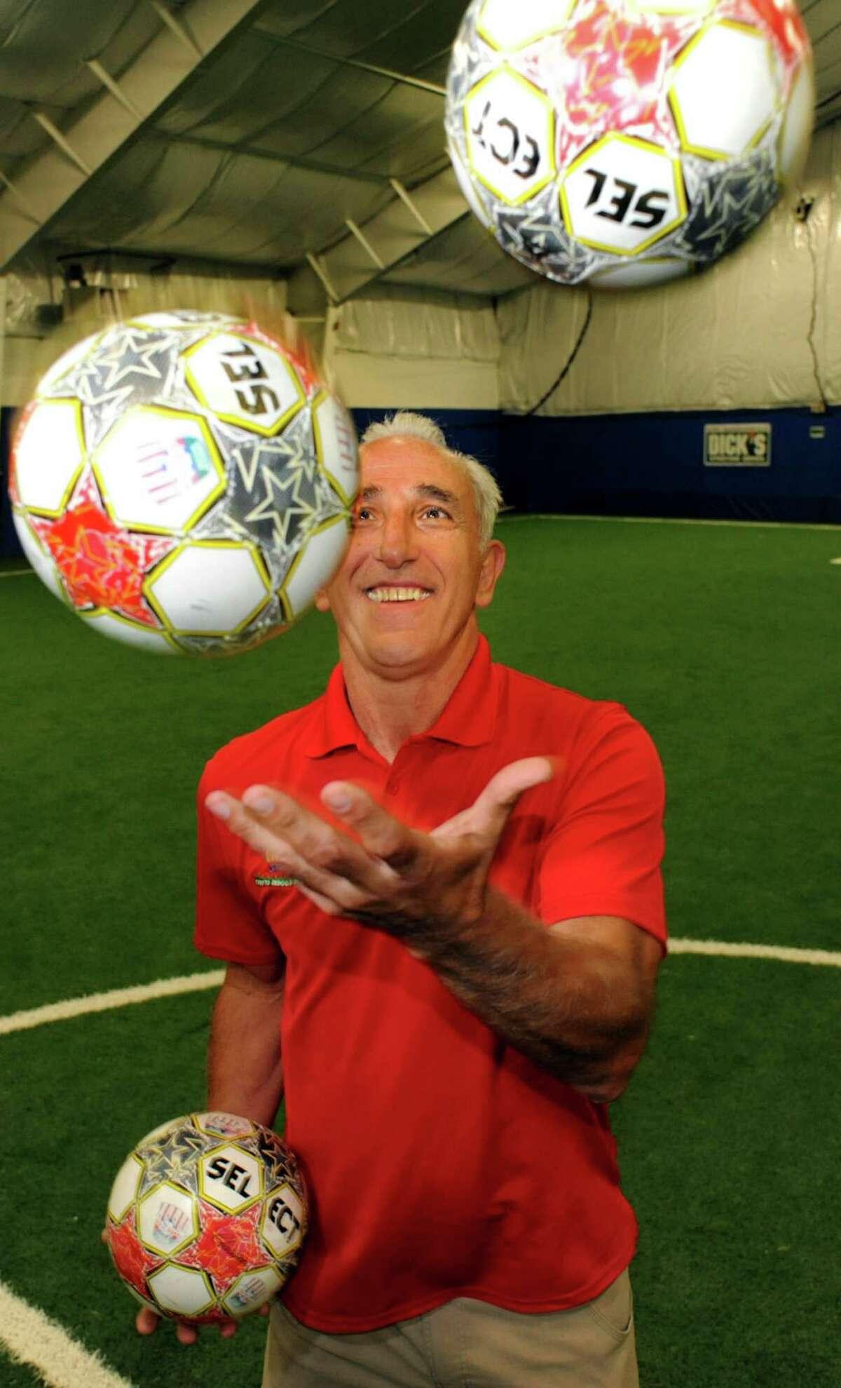 Afrim Nezaj juggles soccer balls on Thursday, Sept. 26, 2013, at Afrim's Sports in Colonie, N.Y. (Cindy Schultz / Times Union)