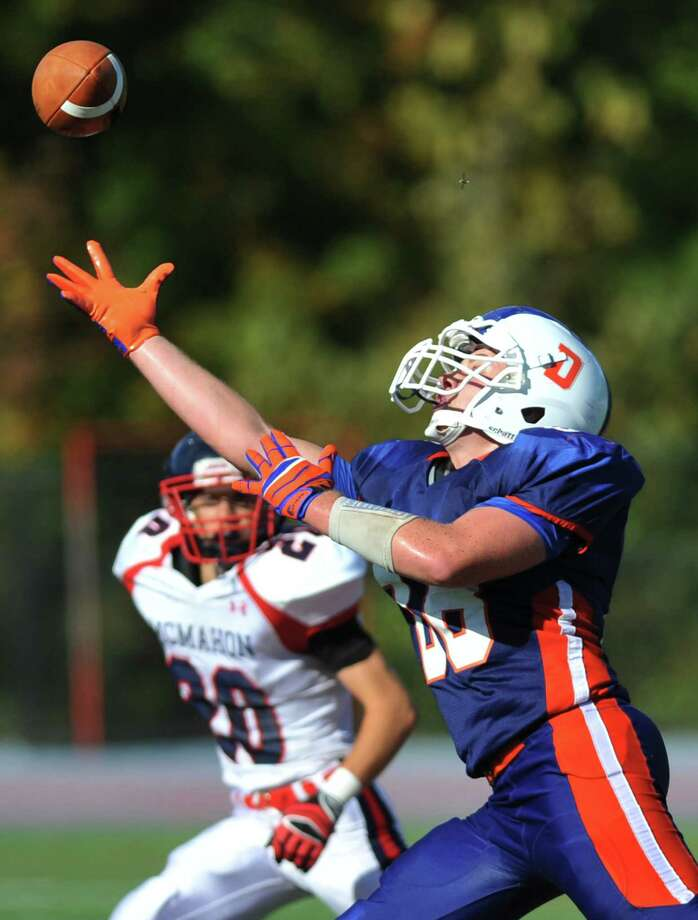 Danbury's Tristan Jacobson reaches out to catch a pass in the FCIAC high school football game between Danbury and Brien McMahon at Danbury High School in Danbury, Conn. on Tuesday, Sept. 24, 2013.  Brien McMahon defeated Danbury, 21-7. Photo: Tyler Sizemore / The News-Times
