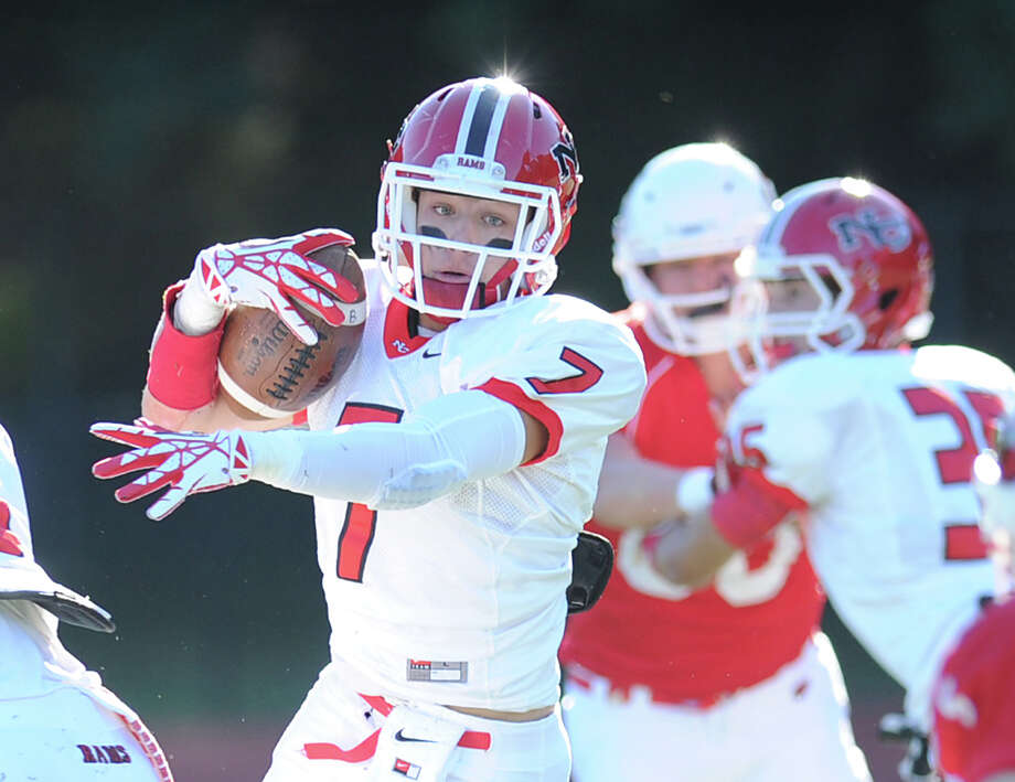 Alex LaPolice (# 7) in action during the high school football game between Greenwich High School and New Canaan High School at Greenwich, Saturday, Sept. 28, 2013. Photo: Bob Luckey / Greenwich Time